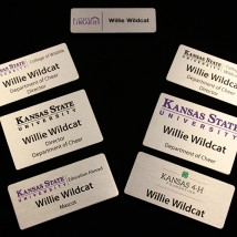 Various Alumajet name badges