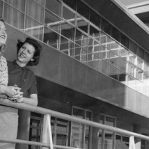 1950s women looking out from balcony