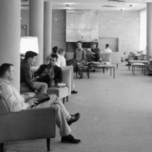 1960s students seated in open lounge area
