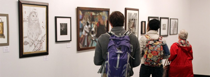 visitors looking at gallery exhibit
