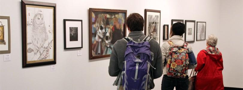 visitors looking at gallery exhibit