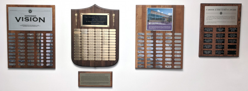 four plaques hanging on wall