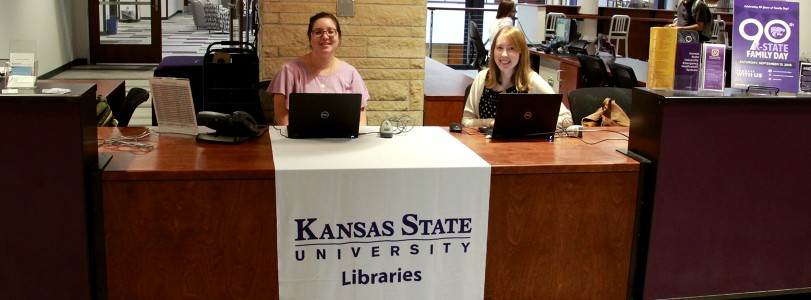 staff sitting at Library Help Desk