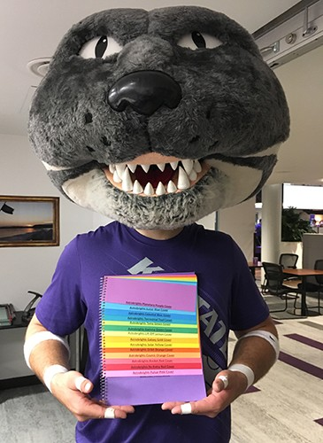 Willie the Wildcat holding paper samples