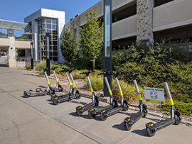 e-scooters parked between Union and parking garage