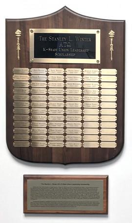 name plaque with descriptive plaque hanging beneath